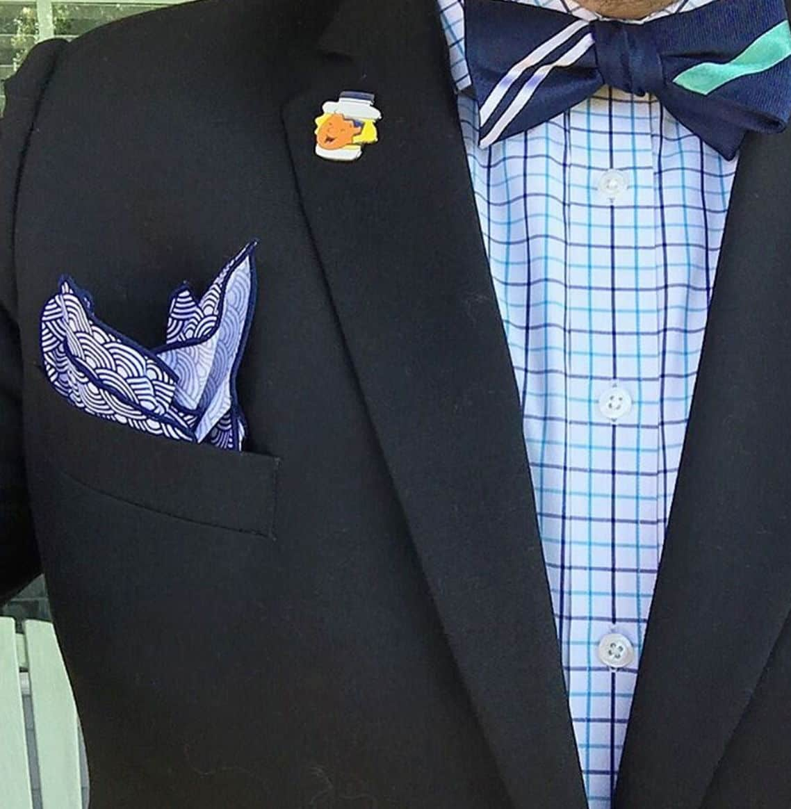 bow tie with charcoal suit and blue bow tie