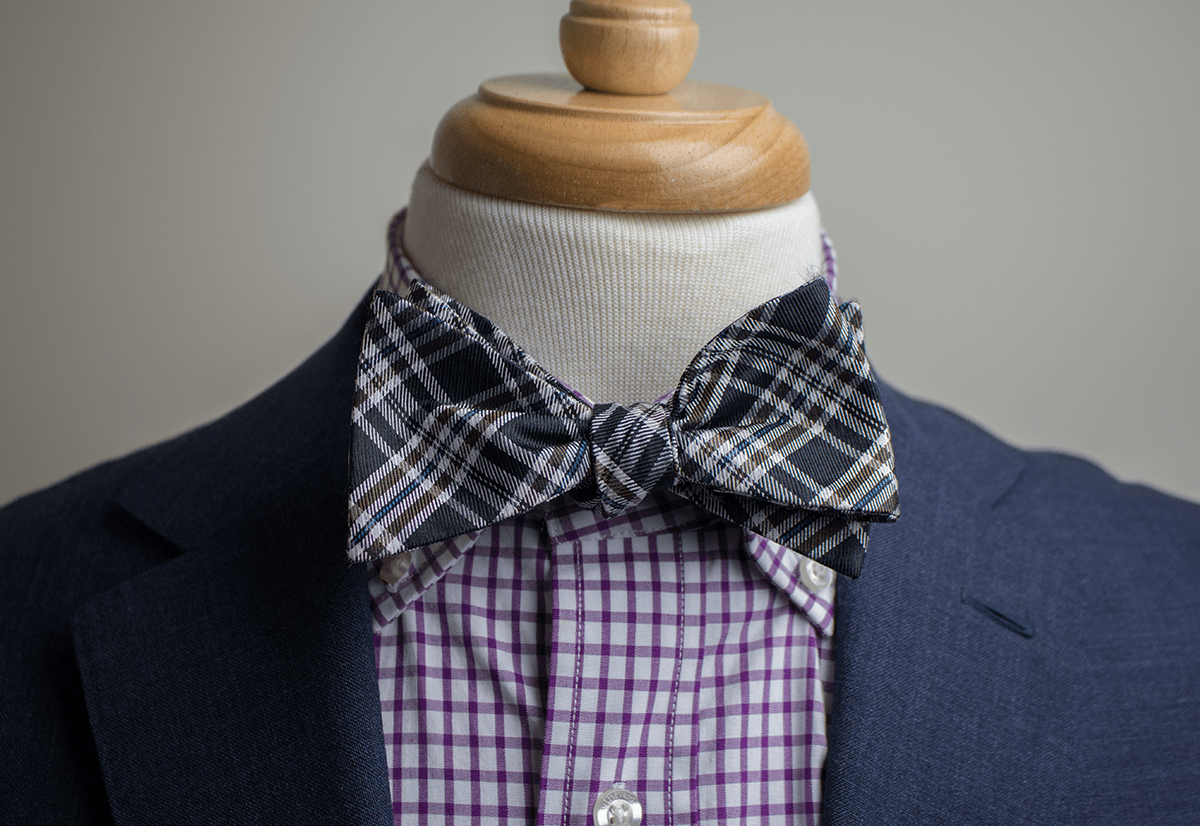 button down collar with a bow tie
