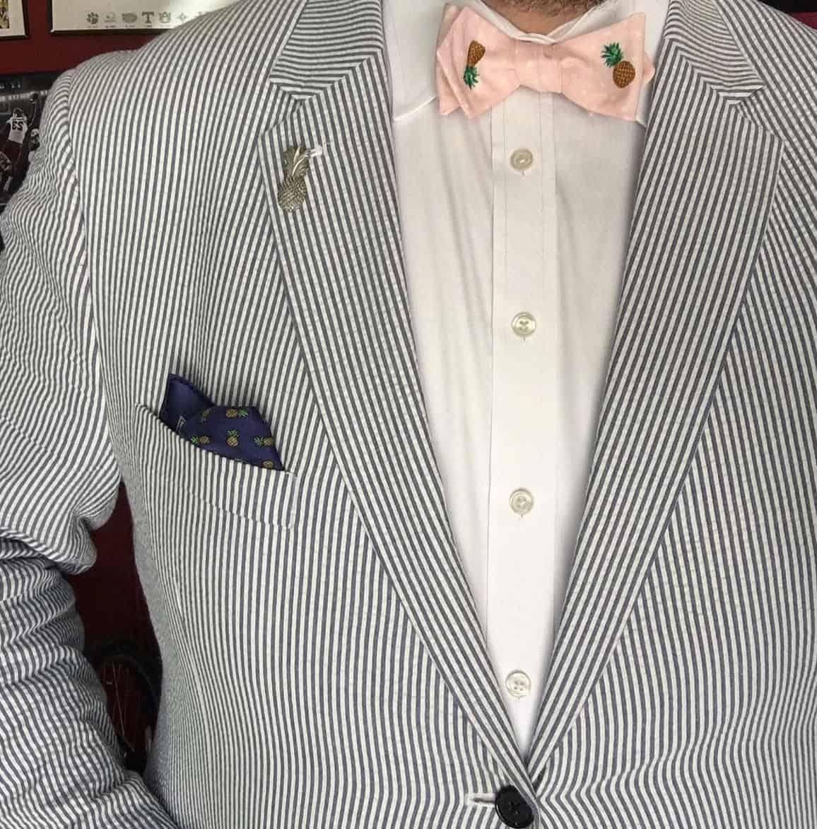 seersucker suit with pink bow tie