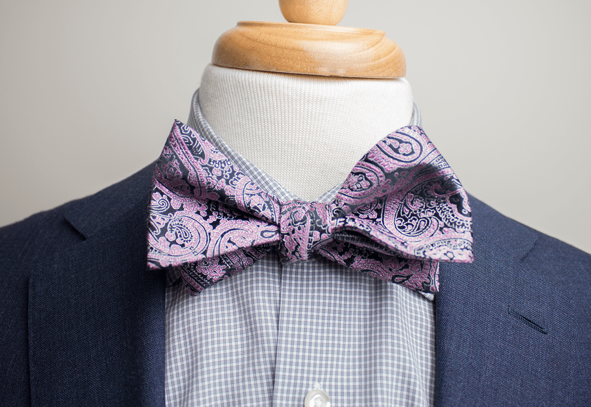 wide spread collar with a bow tie