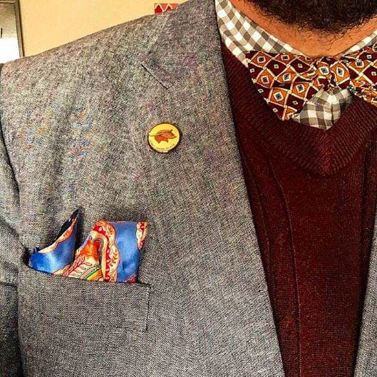 patterned bow tie with maroon sweater