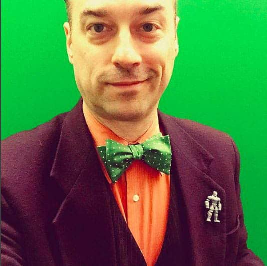 Suit Jacket And Green Bow Tie