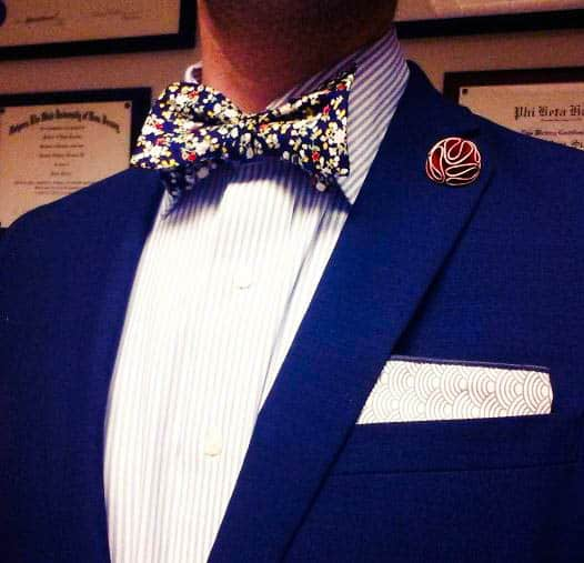 Navy Jacket, Striped Shirt, And Floral Bow Tie