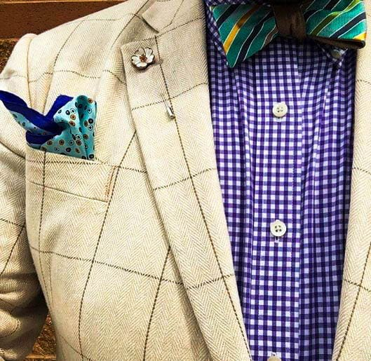 Herringbone Suit Jacket, Gingham Shirt, And Striped Bow Tie