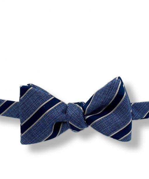 Aberdeen-blue-striped-silk-wool-self-tie-bow-tie that is shown tied