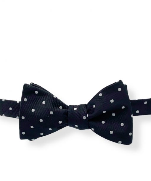 black silver polka dot silk bow tie that is self tie and shown tied