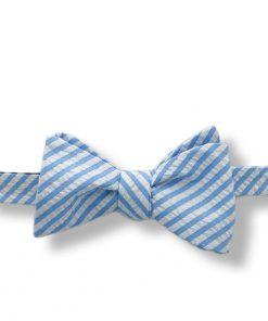 blue cotton seersucker bow tie that is self tie and shown tied