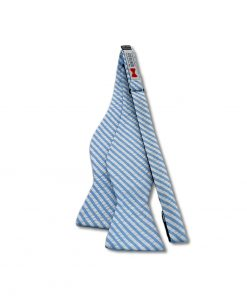 blue cotton seersucker bow tie that is self tie and shown untied