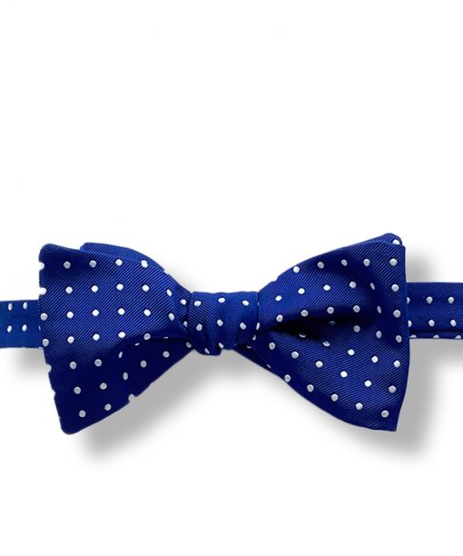 blue polka dot italian silk bow tie that is self tie and shown tied