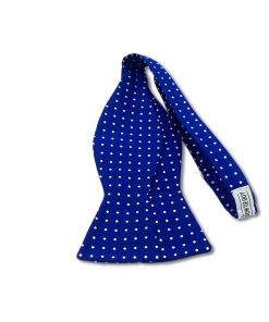 blue polka dot italian silk bow tie that is self tie and shown untied
