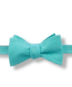 bright green houndstooth cotton bow tie that is self tie and shown tied