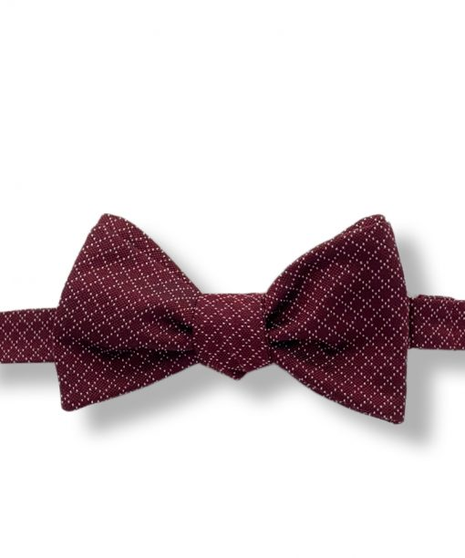burgundy jacquard italian silk bow tie that is self tie and shown tied