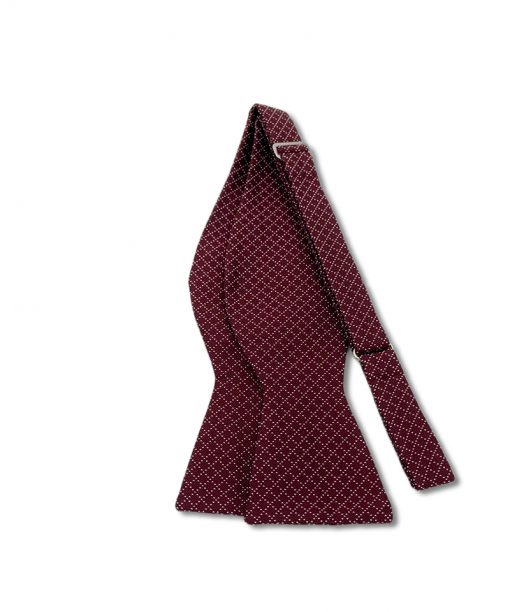 burgundy jacquard italian silk bow tie that is self tie and shown untied
