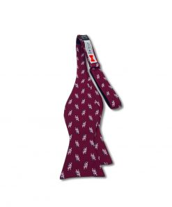 burgundy pigs fly novelty silk bow tie that is self tie and shown untied