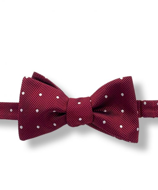 burgundy polka dot italian silk bow tie that is self tie and shown tied