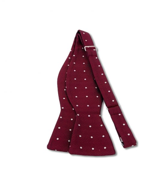 burgundy polka dot italian silk bow tie that is self tie and shown untied