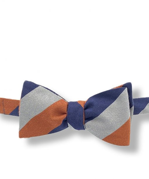 coarshire-rust-striped-silk-wool-self-tie-bow-tie that is shown tied