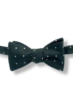 dark green polka dot italian silk bow tie that is self tie and shown tied