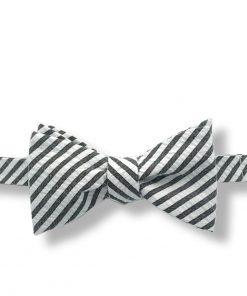 gray seersucker cotton bow tie that is self tie and shown tied