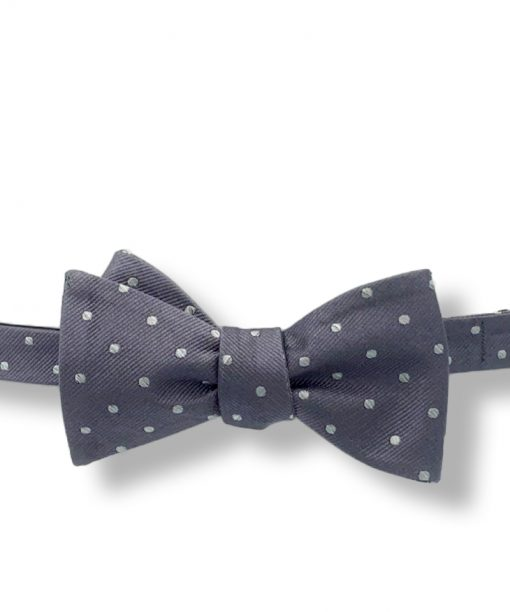 gray silver polka dot silk bow tie that is self tie and shown tied