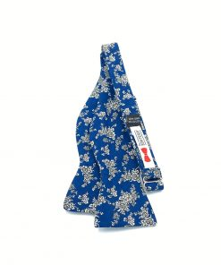 kircaldy-blue-floral-cotton-self-tie-bow-tie that is shown untied