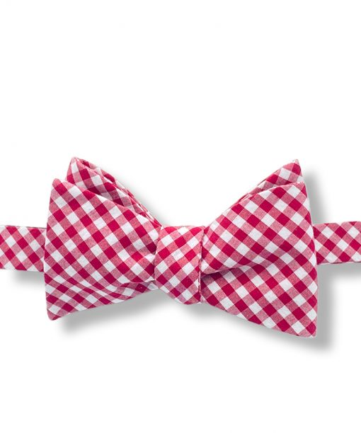 light red and white gingham checkered cotton self tie bow tie that is shown tied