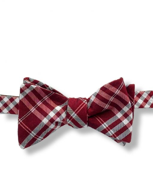 a maroon red plaid silk self tie bow tie shown tied