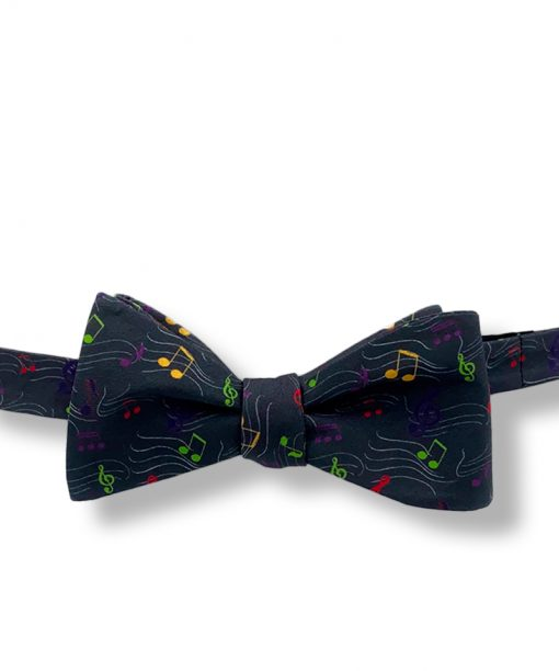 a bow tie with music notes pattern in charcoal gray color this is self tie and show tied