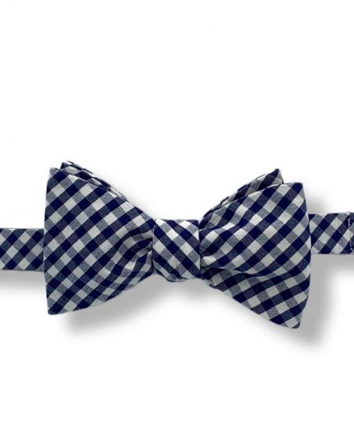 navy blue gingham cotton bow tie that is self tie and shown tied