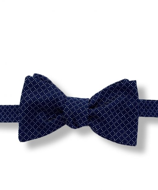 navy blue jacquard italian silk bow tie that is self tie and shown tied