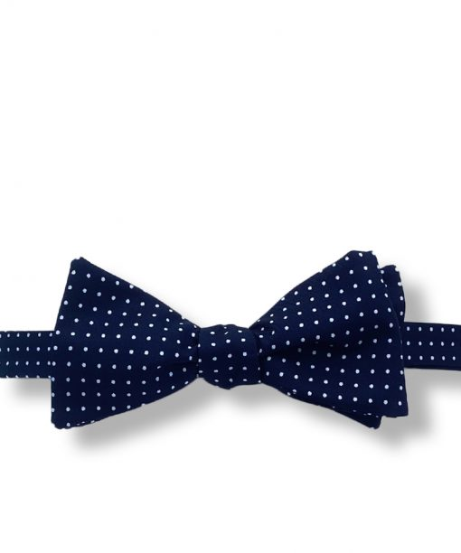 navy blue mini polka dot bow tie that is self tie and shown tied