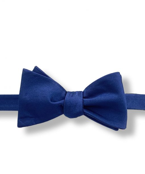 navy blue silk bow tie that is self tie and shown tied