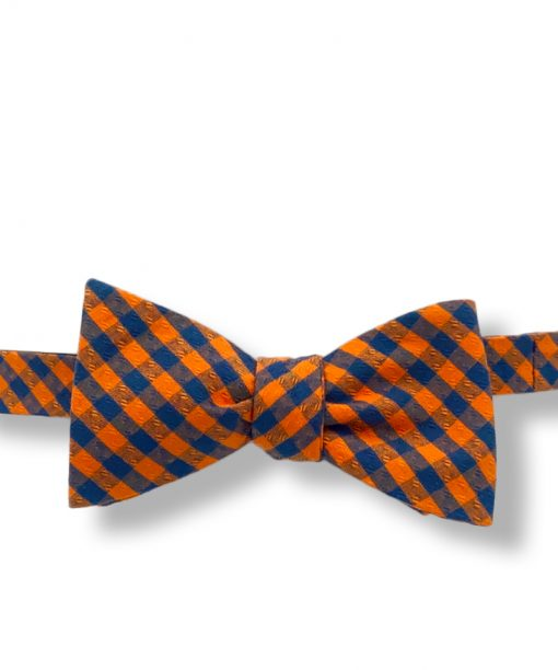 orange and navy blue gingham cotton bow tie that is self tie and shown tied