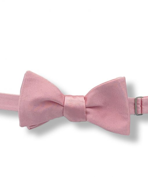 pink italian silk bow tie with grosgrain that is self tie and shown tied