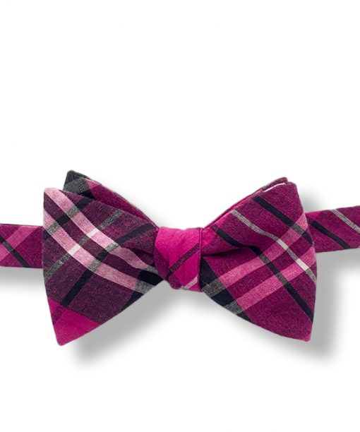 pink plaid cotton bow tie that is self tie and shown tied