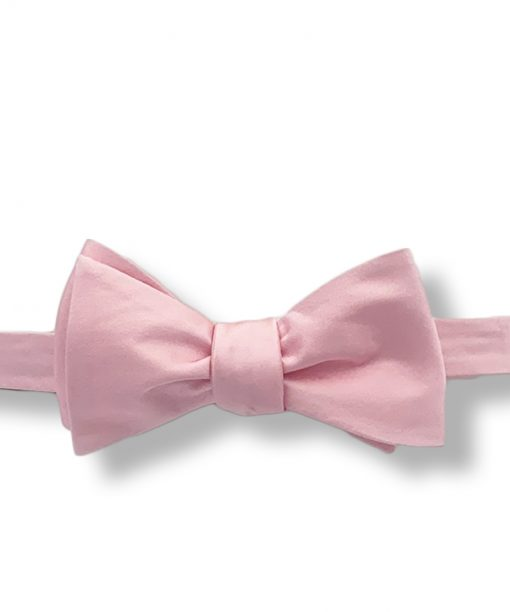 pink silk bow tie that is self tie and shown tied