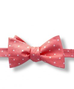 a pink bow tie with white polka dots silk material self tie and shown tied