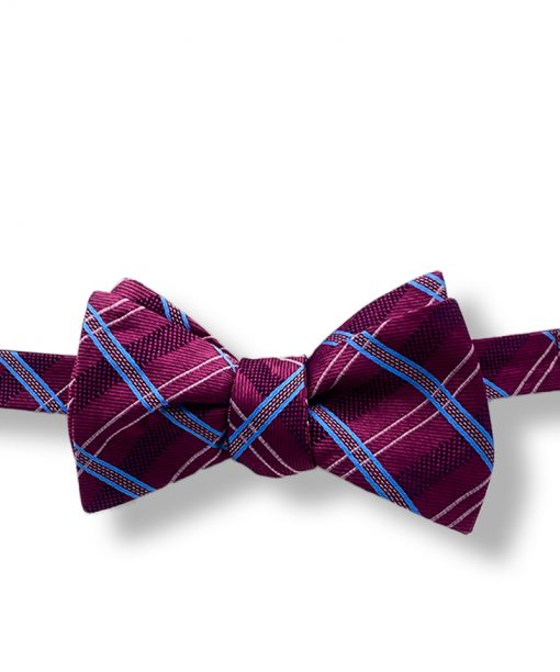 purple plaid silk bow tie that is self tie and shown tied