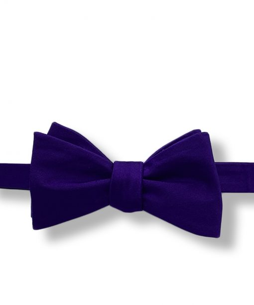 purple silk bow tie that is self tie and shown tied