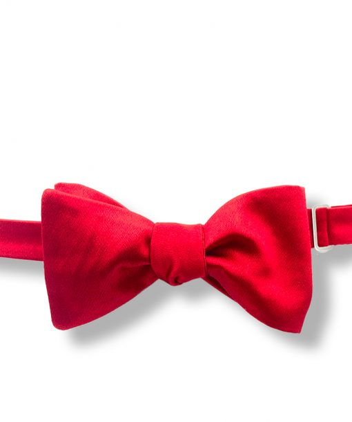 red italian silk bow tie that is self tie and shown tied
