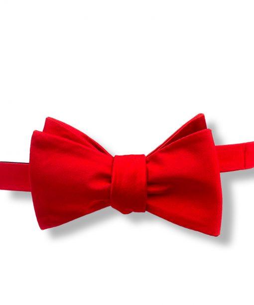 solid red color silk self tie bow tie shown tied