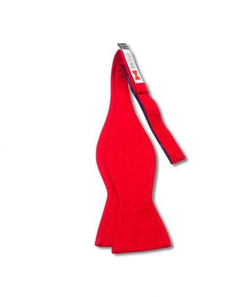 solid red color silk self tie bow tie shown untied