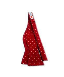 red and white polka dot silk self tie bow tie that is shown untied